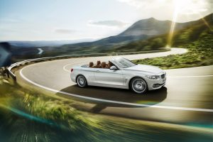 2014-BMW-428i-passengers-side-in-motion